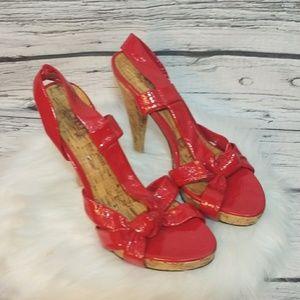 JLO Jennifer Lopez strappy patent leather red heel